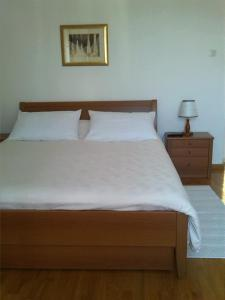 A bed or beds in a room at Rooms Katica