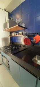 A kitchen or kitchenette at Camburi Apartament