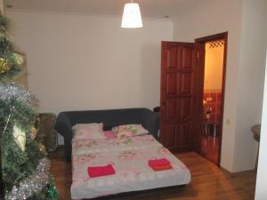 Кровать или кровати в номере Суздаль Комфорт