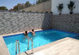 The swimming pool at or near Apartmentos Corona