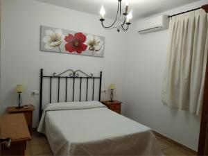 A bed or beds in a room at Apartmentos Corona