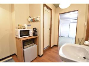 A kitchen or kitchenette at Guest House hanare - Vacation STAY 86077