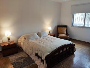 A bed or beds in a room at Finca Viñas de Luján, Casa entre viñedos orgánicos, camino del vino
