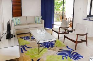 A seating area at Freestyle Resort Port Douglas