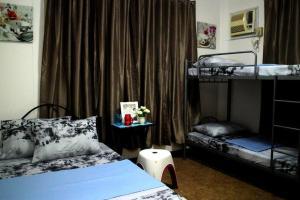 A bunk bed or bunk beds in a room at Tropical Breeze Hostel Cebu - Cebu Center