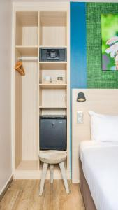 A television and/or entertainment center at Hotel Gondwana - ECO-FRIENDLY