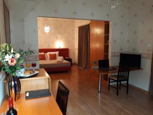 Χώρος καθιστικού στο Grand Olympic Hotel Loutraki