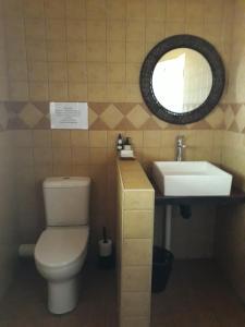 A bathroom at Raintree Guest House