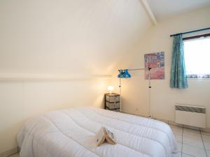 A bed or beds in a room at Apartment Clos des Dunes