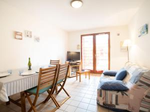 A seating area at Apartment Le Clos Mathilde-10