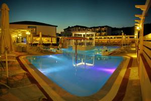The swimming pool at or near Aphrodite Beach Hotel