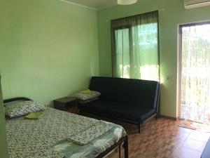 Кровать или кровати в номере Азов Солнечный
