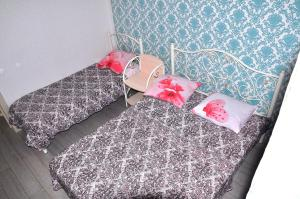 A bed or beds in a room at Апартаменты Фета