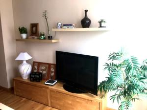 A television and/or entertainment center at Marieta