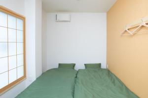 OYO Hotel Kaien Aizuwakamatsuにあるベッド