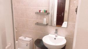 A bathroom at Rising Dragon Legend Hotel