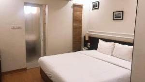 A bed or beds in a room at Rising Dragon Legend Hotel