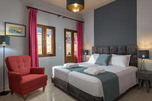 A bed or beds in a room at Grace Hotel & Studios