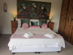 A bed or beds in a room at Dio Dell Amore Guest House