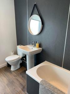 A bathroom at Town Centre Apartment