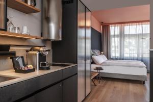 A kitchen or kitchenette at Sorell Hotel City Weissenstein