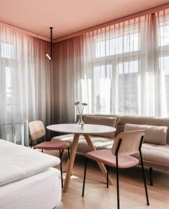 A seating area at Sorell Hotel City Weissenstein