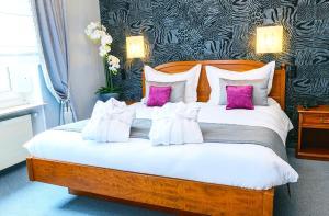 Ein Bett oder Betten in einem Zimmer der Unterkunft Hotel Bel Air Sport & Wellness