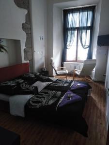 Postel nebo postele na pokoji v ubytování Penzion Willa