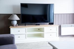 A television and/or entertainment center at Bed & Beach Sydney