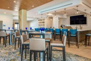 A restaurant or other place to eat at Cambria Hotel St Petersburg-Madeira Beach Marina