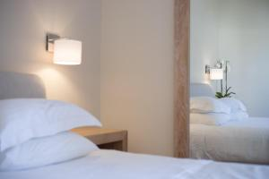 A bed or beds in a room at Porto Naxos