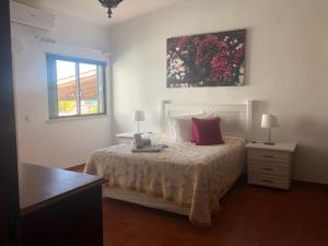 A bed or beds in a room at Villa Tibouchina