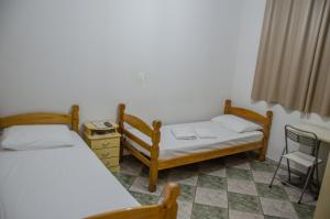 A bed or beds in a room at Hotel Pousada Do Leão