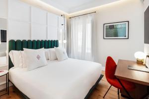 One Shot Palacio Conde de Torrejón 09 tesisinde bir odada yatak veya yataklar