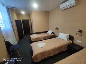 A bed or beds in a room at Mars Hotel
