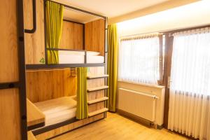 A bunk bed or bunk beds in a room at Das Ebertor - Hotel & Hostel