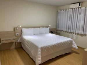 A bed or beds in a room at HD Plaza Hotel