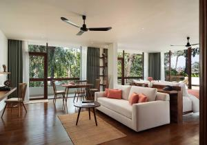 A seating area at FCC Angkor by Avani