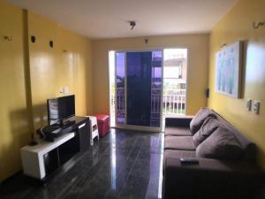 A seating area at Apartamento Mobiliado Vila Iracema