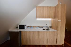 A kitchen or kitchenette at Treetops Eco Loft