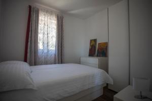 Postel nebo postele na pokoji v ubytování Ivana