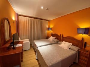 A bed or beds in a room at Tierra De Lobos
