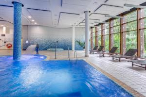 The swimming pool at or near Holiday Inn Warsaw Józefów