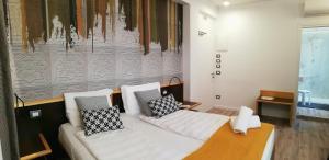 Cama ou camas em um quarto em Hotel Belvedere