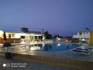 The swimming pool at or close to Villa Popi Studios