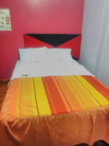 A bed or beds in a room at Casa Talenttus House Students