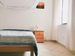 A bed or beds in a room at Casa Mar Surf House