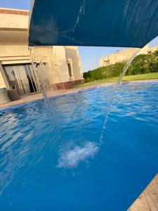 The swimming pool at or near Villa du bonheur (Appel Garden)