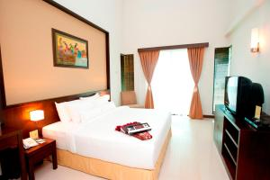 A bed or beds in a room at Felda Residence Tanjung Leman
