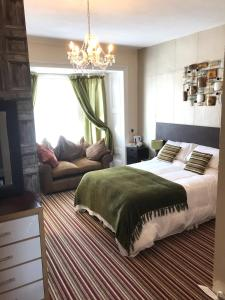 A bed or beds in a room at Wighthill Hotel
